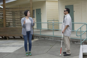 Instructor and client with cane