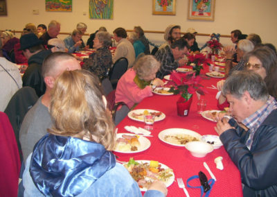 almost-one-hundred-guests-enjoy-a-holiday-meal72
