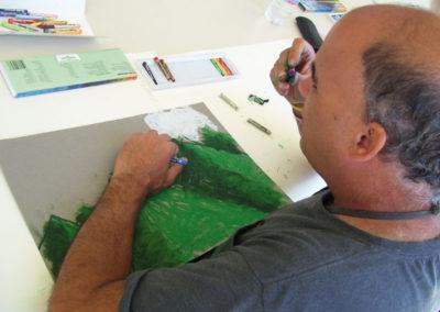 artist-ken-chooses-a-color-in-his-ebc-art-class72