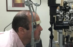 Nick  sitting in position with the eye exam gear