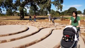 Youth and baby walk labyrinth