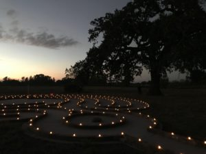 labyrinth at sunset outlined with votive candles