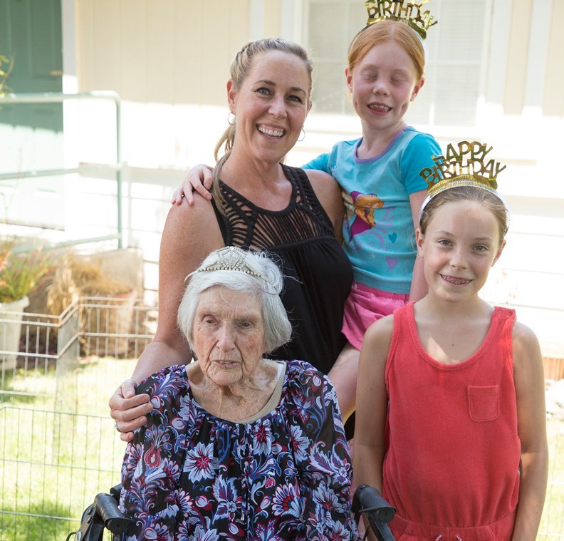 Laurie celebrates her 100th birthday with granddaughter Edie and great-granddaughters Aliana (top) and Katrina.