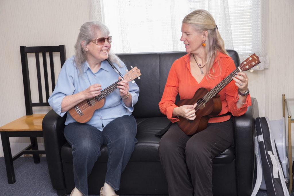 Nancy and EBC Instructor Denise Vancil practice the ukulele